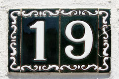 Spanish street number 19 Stock Photos