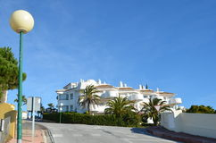 Spanish style apartments Calahonda Spain. Sunny afternoon view of Spanish style apartments near the top of the Sitio de Calahonda Costa del Sol Spain Royalty Free Stock Images