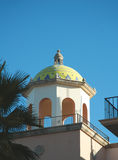 Spanish style dome. Spanish style building dome. It's a sunny day with a clear blue sky Royalty Free Stock Images