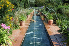 Fountains in a Spanish style garden. Scenic view of fountains in a beautiful Spanish style formal garden Royalty Free Stock Photo