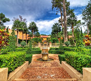 Spanish style garden. On cloudy day, HDR process Royalty Free Stock Image
