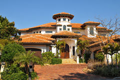 Spanish style home with tower, tiled roofs Stock Photo