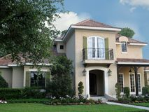 Spanish-styled Home. Beautiful, upscale Spanish-style architecture with landscaped lawn stock photo