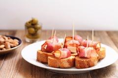Spanish tapa with bacon royalty free stock image