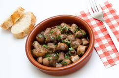 Spanish tapa casserole with mushrooms and parsley Royalty Free Stock Images