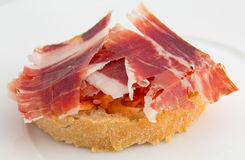 Spanish tapa, ham and tomato Stock Photos