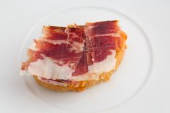 Spanish tapa, ham and tomato Stock Image