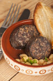 Spanish tapa morcilla with chick peas Stock Photography
