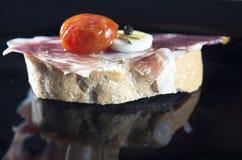 Spanish tapa of serrano ham served on sliced bread Stock Photo