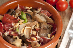 Spanish tapa, setas con jamon. Oyster mushrooms, serrano ham and pine nuts tapas.  Setas con jamon y pinones Stock Photos