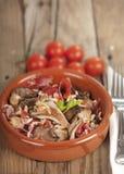 Spanish tapa, setas con jamon. Oyster mushrooms, serrano ham and pine nuts tapas.  Setas con jamon y pinones Stock Photo