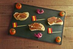 Spanish tapa on a slate plate Stock Photo