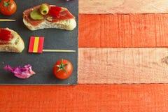 Spanish tapa on a slate plate Stock Photography