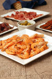 Spanish tapas. Fours dishes and a bowl with an assortment of Spanish tapas Stock Photos