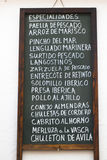 Spanish tapas advertised. On a blackboard in Granada Royalty Free Stock Photo