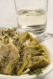 Spanish tapas. Artichokes in vinaigrette. Stock Photos