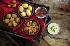 Spanish tapas as party appetizers , baked olives, prawn shrimps, Stock Photos
