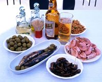 Spanish tapas and beer. Royalty Free Stock Photos