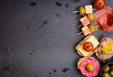 Spanish tapas on a black stone background Royalty Free Stock Images