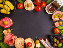 Spanish tapas on a black stone background Stock Image