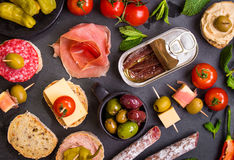 Spanish tapas on a black stone Royalty Free Stock Photography