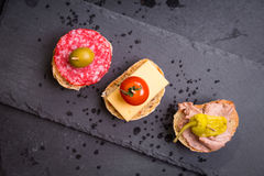 Spanish tapas on a black stone Royalty Free Stock Image