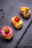 Spanish tapas on a black stone Royalty Free Stock Photo