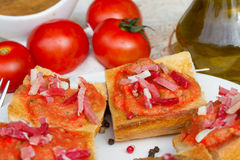Spanish tapas    - bread with tomatoes and jamon Stock Image