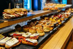 Spanish tapas called pintxos of the Basque country. Served on a bar counter in a restaurant in San Sebastian, Spain royalty free stock images