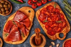 Spanish tapas with  chorizo,  jamon, picnic table. Spanish tapas with  chorizo,  jamon, picnic table, top view Royalty Free Stock Photo