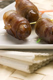 Spanish tapas. Date wrapped in bacon. Stock Photography
