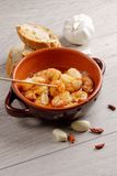 Spanish tapas dish, sizzling prawns Royalty Free Stock Photos