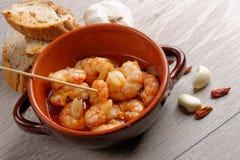 Spanish tapas dish, sizzling prawns Royalty Free Stock Image