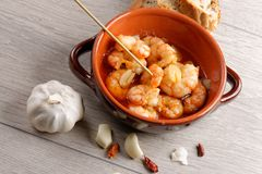 Spanish tapas dish, sizzling prawns Royalty Free Stock Photo