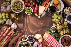 Spanish tapas food border frame. On wooden table overhead view Royalty Free Stock Image