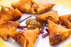 Spanish Tapas fried filled pastry triangles. Spanish Tapas plate with golden fried filled pastry triangles and sauce Royalty Free Stock Photo