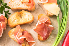 Spanish tapas with jamon, cheese, tomato and garlic Stock Photography