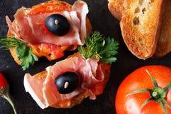 Spanish tapas with jamon and tomato Stock Photography