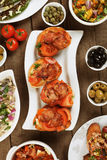 Spanish tapas menu. Tapas or antipasto food, mediterranean cold buffet great for parties Stock Photos