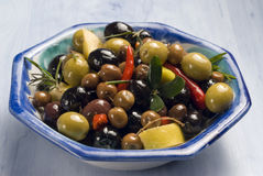 Spanish tapas. Olives in a blue plate. Royalty Free Stock Image