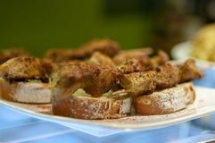 Spanish tapas. Pinchos morunos on bread. Montaditos royalty free stock photography