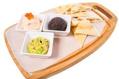 Spanish tapas platter with various pates. Stock Photos