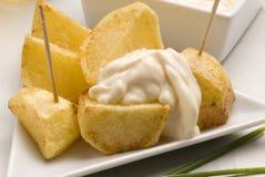 Spanish tapas.Potatoes in sauce. Stock Image