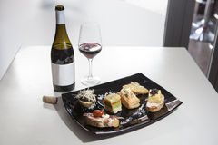 Spanish tapas and red wine Stock Photography