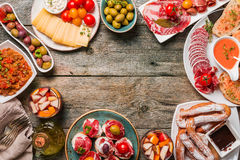 Spanish tapas and sangria. On wooden table, top view ith copy space Stock Photos
