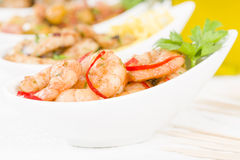 Spanish Tapas. Setas al Ajillo (sauteed mushrooms with garlic), Gambas Pil Pil (sizzling prawns), Pollo al limon con ajo (chicken with garlic) and Habas Con Stock Image