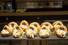 Spanish tapas of shrimp, black caviar and salad. Royalty Free Stock Photo