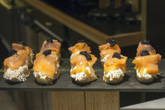Spanish tapas of smoked salmon and black caviar. Stock Images