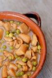 Spanish Tapas, Squid with green peas Royalty Free Stock Photos