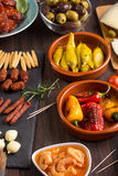Spanish tapas starters on wooden table Royalty Free Stock Photos